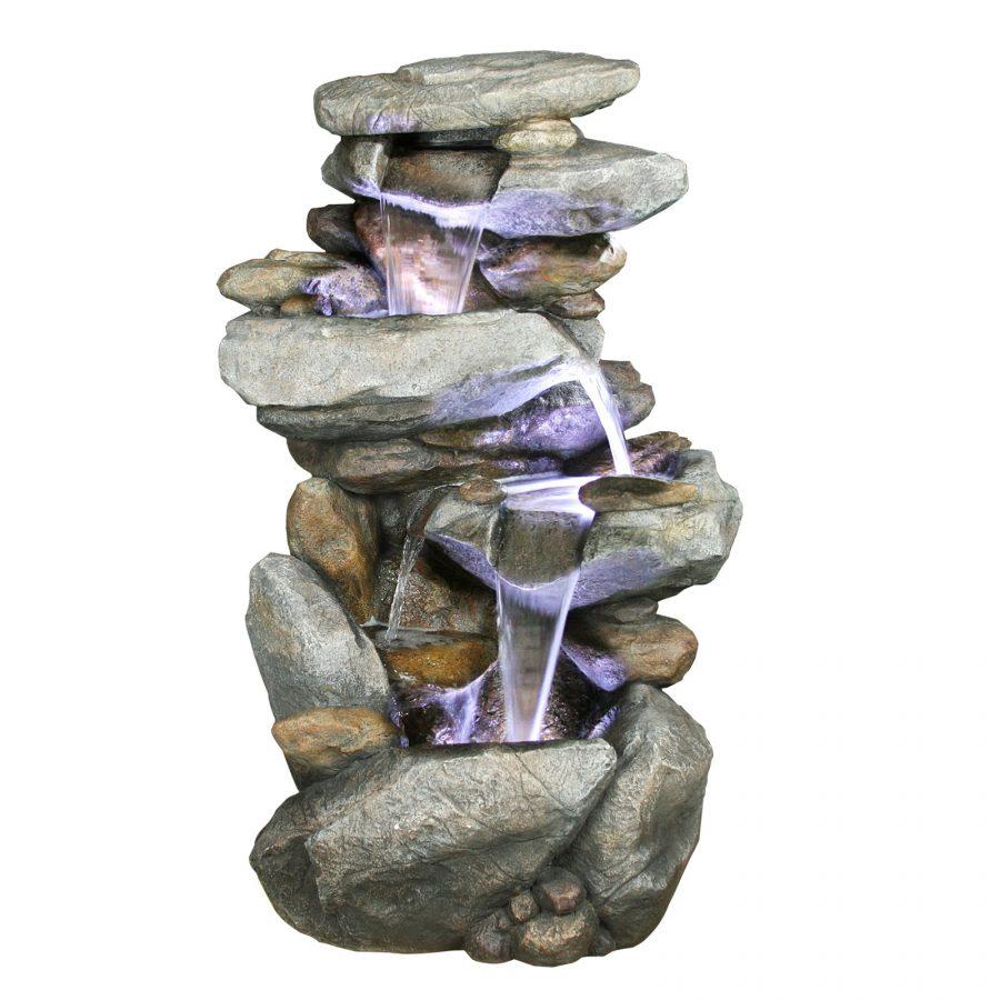 Малоформатный водопад с подсветкой, сложенный из необработанного природного камня будет хорошо выглядеть и во дворе (саду), и в помещении